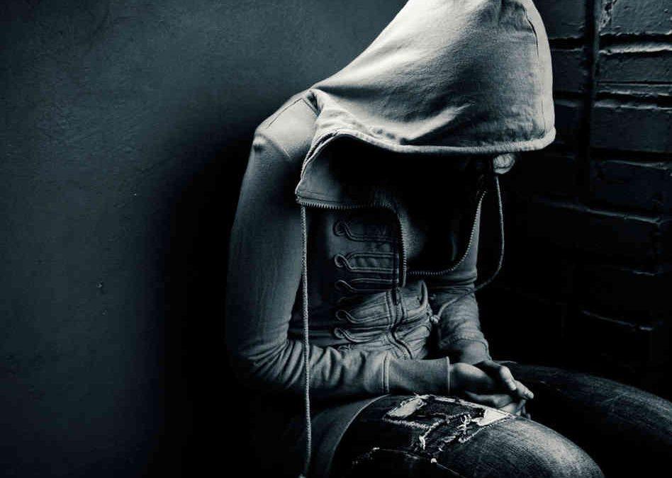 Depressed person wearing a hoodie